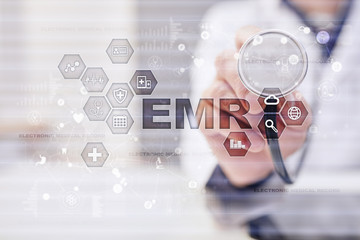 Electronic health record. EHR, EMR. Medicine and healthcare concept. Medical doctor working with modern pc.?