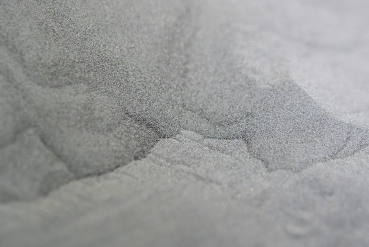 3D printer printing metal. Metallic powder for laser sintering machine for metal. Metal powder is sintered under of laser into desired shape. Modern additive technologies 4.0 industrial revolution