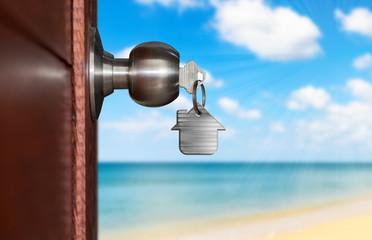 Open door with keys, Door opening onto beach