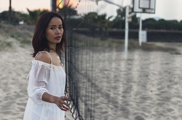 Indonesian woman with white lightweight beach lifestyle dress