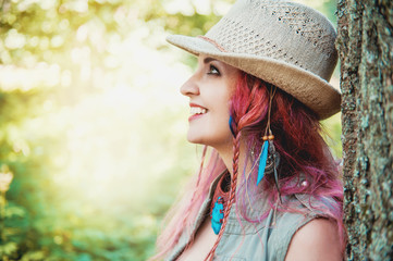 Portrait of beautiful woman boho style in hat
