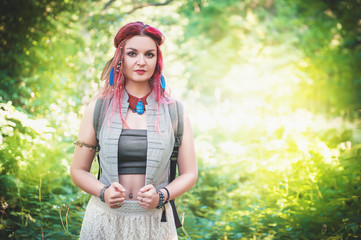 Portrait of beautiful woman boho style with red hair