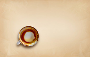 hot coffee that has almost been drunk on brown paper background  with space for text. top view