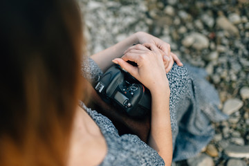 The girl's hands of the photographer who hold the camera