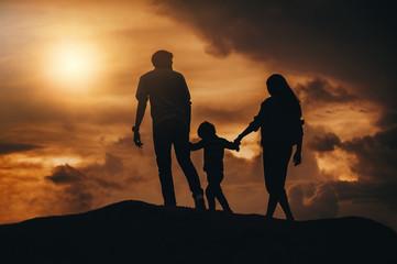 Silhouette happy family at sunset, parents, children Love affair concept