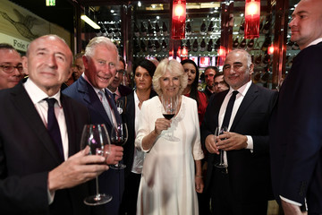 Britain's Prince Charles, the Prince of Wales and Camilla, the Duchess of Cornwall, French Interior Minister Gerard Collomb and Lyon's Mayor Georges Kepenekian visit the Halles de Lyon market