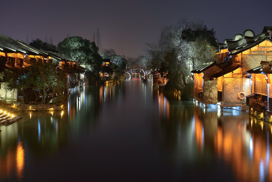 Night view of the ancient building by the water in Wuzhen. Wuzhen - historic ancient water town, part of Tongxiang, located in northern Zhejiang Province, China