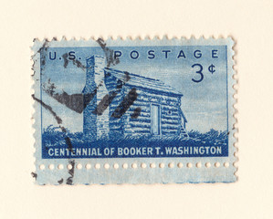 An old blue american postage stamp celebrating the centennial of african american author booker t Washington in 1956
