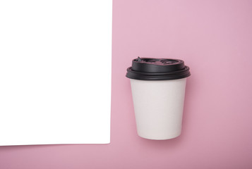 Coffee paper cup and paper template on pink background. mockup for branding.