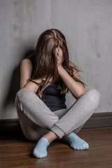 depression teen girl sit on the floor