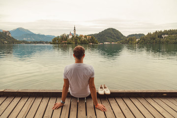 Man relaxing and enjoying the view in nature and lake.