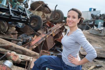 woman working at a car scrapper