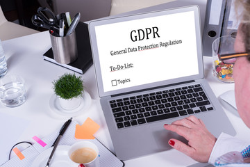 woman working on To-Do-List for GDPR on Laptop
