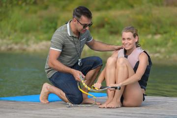 female waterskiier learner with coach