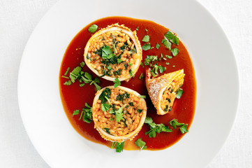 stuffed with rice and spinach seafood in tomato white wine sauce sprinkled with parsley