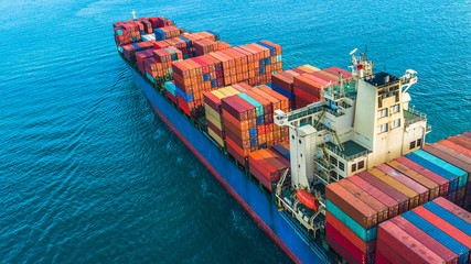 Aerial top view container cargo ship, Business logistic and transportation of International by ship in the open sea. Fototapete