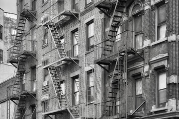 Black and white picture of fire escapes, one of the New York City symbols, USA.
