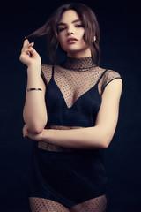 Wall Mural - Sensual beautiful brunette woman in a sexy fashion dress
