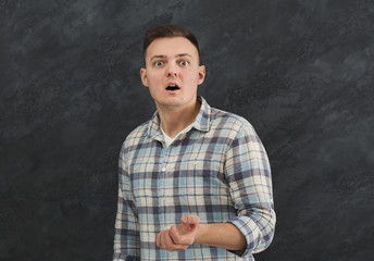 Portrait of young shocked man