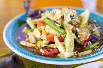 Sofe focus of Spicy Cucumber Salad on table. Thailand food, Som Tum Taeng or cucumber salad Thai style.