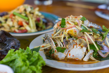 SOM-TAM, Thai delicious raw papaya salad with unique taste hot and spicy, this dish with tomato and crab. Papaya salad with red chili.