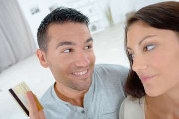 couple with laptop and credit card at home