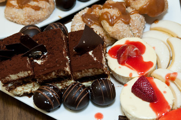 Wedding sweet table, cheesecake, tiramisu, apple crostada, chocolate zuccotto bites, vera lemon cookies