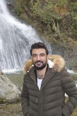 Handsome man is looking at camera in Cunda Island,Turkey