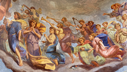 REGGIO EMILIA, ITALY - APRIL 12, 2018: The Fresco of angels with the music instruments in cupola of church Basilica di San Prospero by  C. Manicardi, G. Ferrari and A. Lugli (1884-1885).