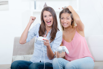 two women playing video game