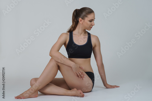 9a1f90f0f91 Beautiful sexy athletic young girl in black lingerie make yoga practice