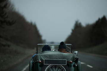 Classic car in country road