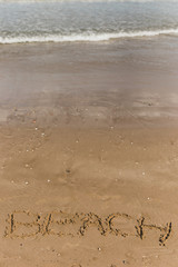Beach concept with letters written in sand