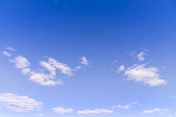 Blue sunny sky with white clouds background and pattern in summer season