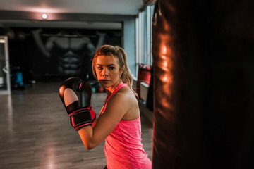 Good-looking woman concentrating on boxing.