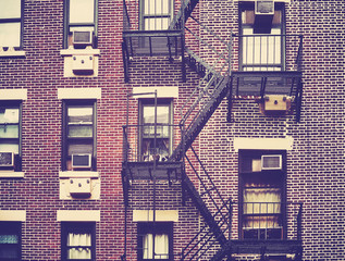 Vintage stylized picture of fire escapes, one of the New York City symbols, USA.