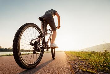 Speedy bicyclist wide angle shoot