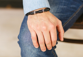 Stylish man's hand.elegant business man's hand with bracelet,hands of a man close-up