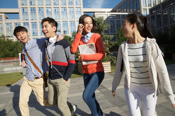 Cheerful college students in college campus