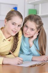 beautiful  girls doing homework