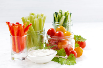 healthy snacks, mixed vegetables and yogurt on a white background, closeup