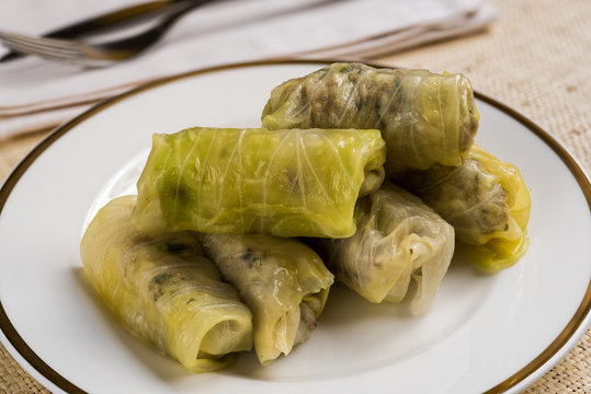 Delicious homemade stuffed cabbage leaves (the traditional dolma of the mediterranean cuisine) in white plate