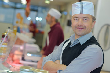 portrait of confident male butchers smiling in butchery