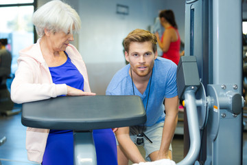 senior woman working out with personal trainer