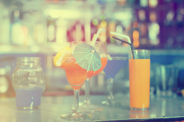 Image of various colorful cocktails on the bar counter