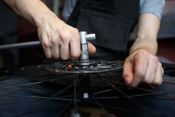 Photo workshop for repairing bicycle wheel.