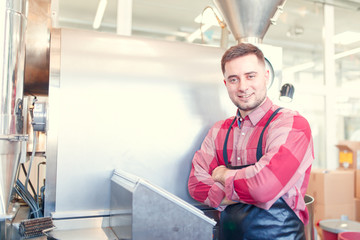 Photo of businessman with arms crossed by roaster