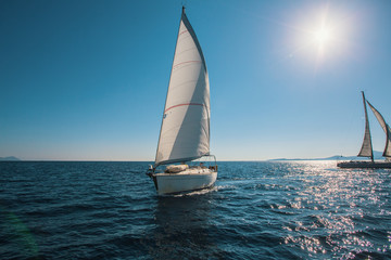 Sailing in the wind through the waves at Sea. Luxury yachts.