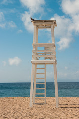 Lifeguard tower on the sandy beach beautiful seascape summer morning Athens, Greece.