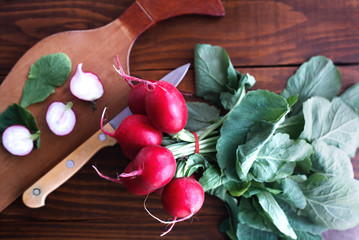 Organic fresh radish on a wooden table